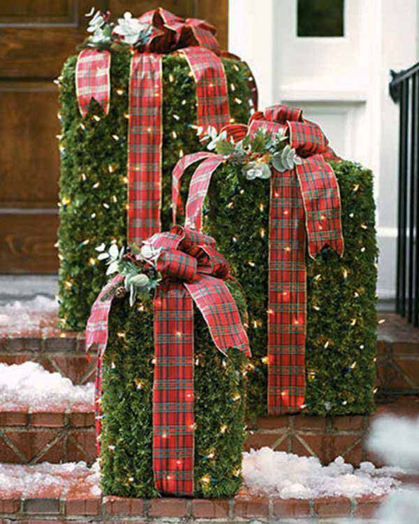 Idea for outdoor Christmas décor - using lighted garland around a wire frame or plastic box. So cute in daytime and at night!