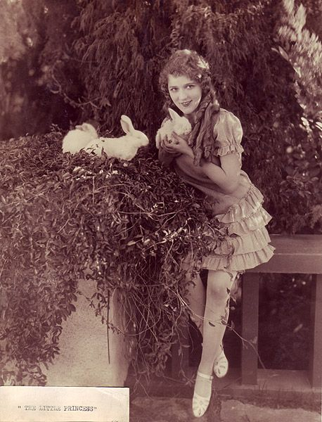 Mary Pickford hamming it up with studio bunnies on the set of The Little Princess (1917), directed by Marshall Neilan.