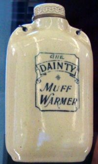 The Dainty Muff Warmer:   A hundred years ago a woman going out in the cold of winter could tuck a miniature hot water bottle inside her fur muff to keep her hands warm