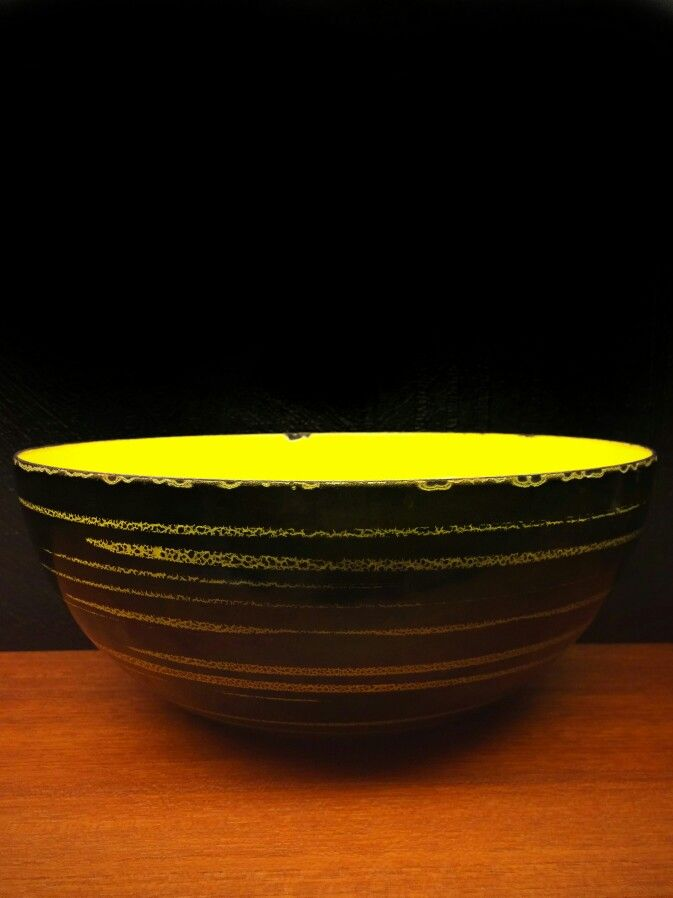 cathrineholm of norway 1958. grete prytz kittelsen. CATHRINE series. PRIKKEDEKOR design. yellow w/ black. iron. ø 20 cm. available in a variety of sizes: 10, 14, 18, 20, (22), 24 and 28. exists only in grayblue, red, yellow and white, all combined with black.
