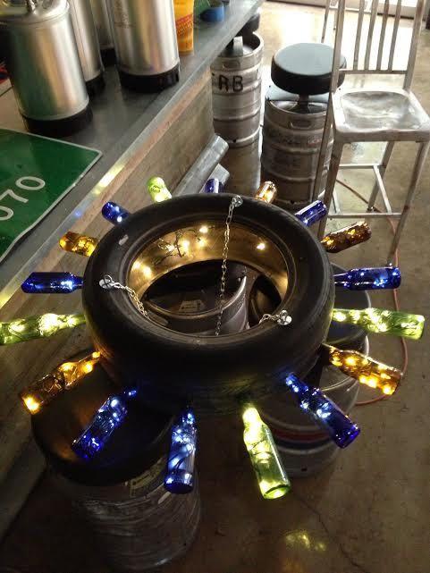 Tire & Beer Bottle Chandelier on Etsy, $300.00