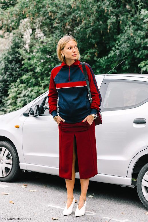 We've heard of athleisure, but what exactly is femleisure? It's the combination of two major trends. Feminine pieces are mixed with sportswear; track pants with ruffled turtlenecks, work out leggings with silky blouses or like how Pernille styled it, track jackets with pencil skirts in a daring hue. It's the best mixture of sporty and chic.