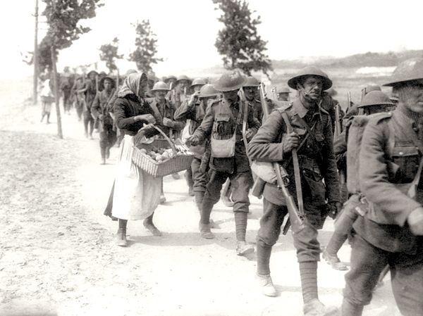 At the end of the Great War, soldiers were returning home. Many of them came back to unemployment and poverty or poor working conditions. This later led to strikes and unions formed to improve pay and working conditions.  (A french women selling food to soldiers returning to camp in 1918)