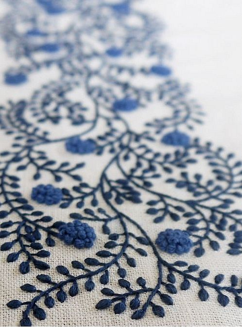 Pretty blue embroidery design featuring vines and clusters of French knots