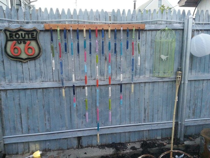 My FREE fence art made with old trampoline springs and a 2x4