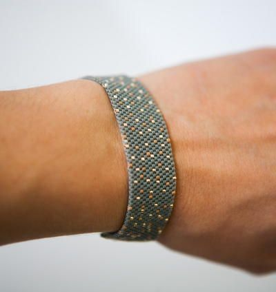 This stunning Gold Speckled Peyote Stitch Bracelet is a versatile piece of DIY jewelry that will quickly become a staple in your collection. This DIY bracelet is great no matter if you're just learning peyote stitch or have it mastered already.