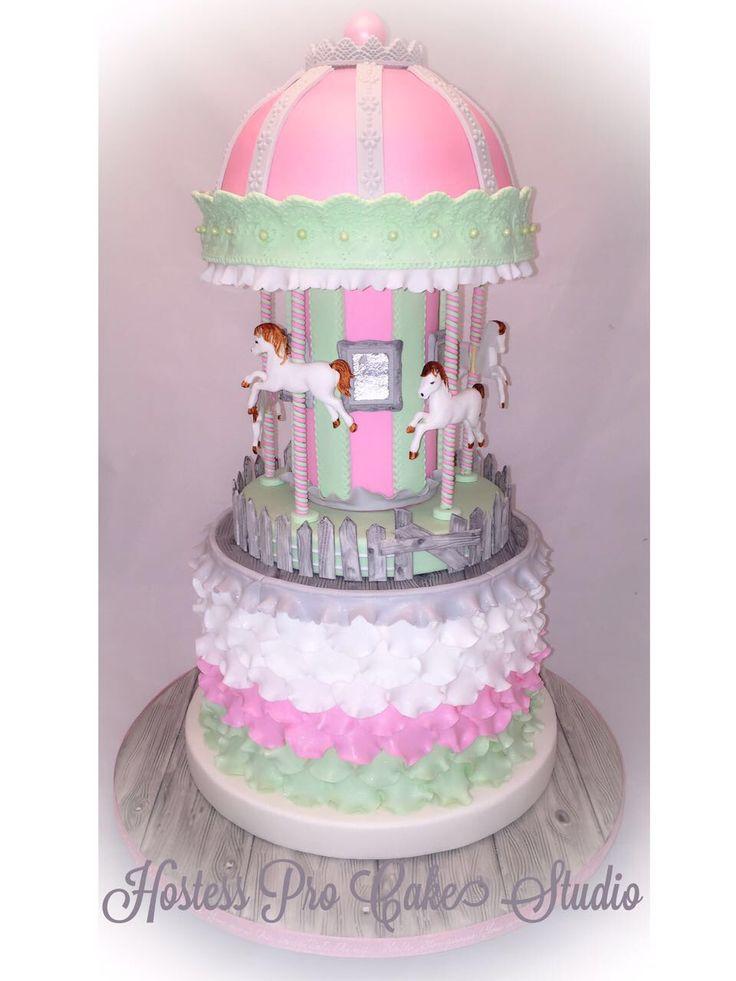 Carousel cake Cake decorating  Pink green white cake