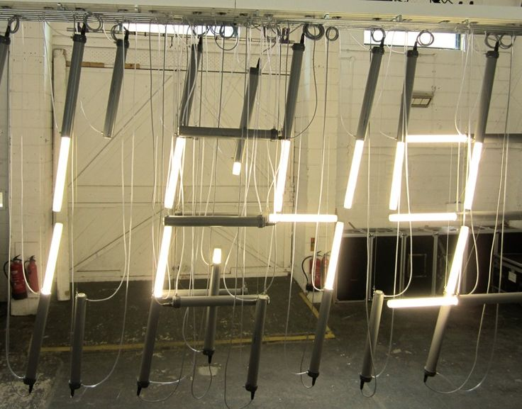 the installation consists of 30 pneumatic moving parts, which have been assembled to form a digital clock display.