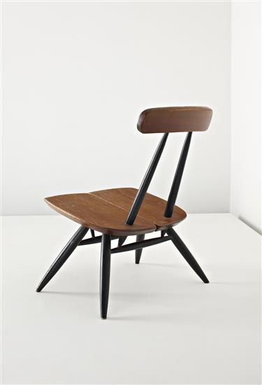 ILMARI TAPIOVAARA Low 'Pirkka' chair, c. 1960 Pine, ebonised wood. 71 cm. (28 in.) high Manufactured by Asko, Finland. Underside of seat impressed with 'LP/LAUKAAN PUUO/MADE IN FINLAND/TAPIOVAARA/DESIGN'.