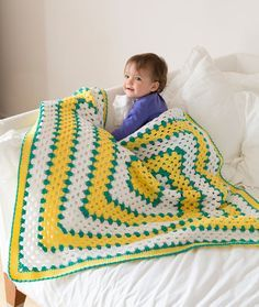 Makin' Squares Blanket - This soft, cuddly blanket is crocheted starting at the center and is really just a great big granny square. Choose from a complete range of bright and pastel hues in the certified, quality yarn.