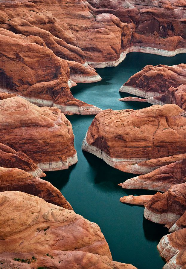 Red canyons of Lake Powell by   Gleb Tarro - Areal view of Lake Powell, Arizona   Great view on this Mars like landscapes but with water... Helicopter helps.  (I'm amazed at how low the water is! Look at the high water marks on the walls...)