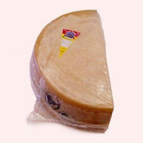 Made from Cow's milk Flavor: Sharp Recommended Wine: Prosecco Grana Padano, Stravecchio Oro Del Tempo Grating Cheese (Whole Wheel) Approximately 80 Lbs
