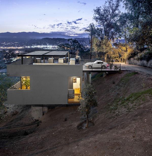 The architects placed the carport on the roof of the house and the residence below, resulting in a dramatic shift of expectations. #architecture #design