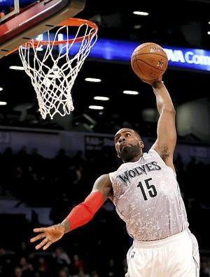 United States Team's Shabazz Muhammad, of the Minnesota Timberwolves, dunks against the World Team during the first half of the Rising Stars NBA