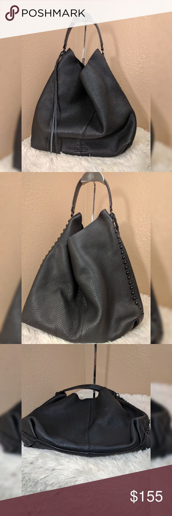"""Rebecca Minkoff Unlined Hobo It's all in the details for this modern hobo from Rebecca Minkoff. Crafted from soft pebbled leather, this wardrobe staple features a slouchy silhouette, a cool metallic interior and just the right amount of studding to make this bag an instant classic.  Magnetic-snap closure.  Removable interior zip pouch.  Unlined.  Leather.  By Rebecca Minkoff;?  Size Info  15""""W x 14""""H x 4 ?""""D. (Interior capacity: large.)  7"""" drop  New without tags, missing inside coin purse…"""