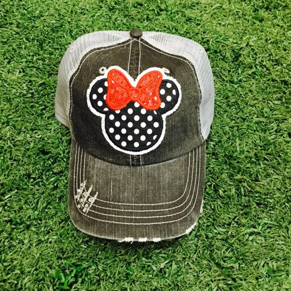 This is a gray trucker baseball hat. If you love Disney, glitter and rhinestones, then this polka dot hat for you! Disneyland or Disney World is added to the brim of the hat in Red glitter :) or you can opt to leave it off all together. Let us know at checkout which one you would like. We also have a chevron Minnie hat and a pink Minnie. These can be found in other listing on our page. This hat is adjustable. All products are made when you order Be sure to find Chasing Elly on Facebook to…