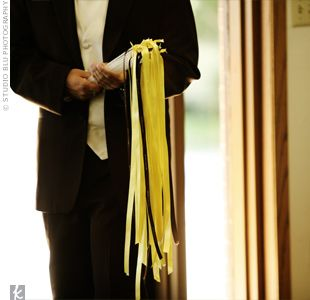 As soon as the ceremony was over, an usher handed out brown and yellow ribbon wands and small packets of eco-confetti from EcoParti.com to all the guests just in time for the couple's exit.