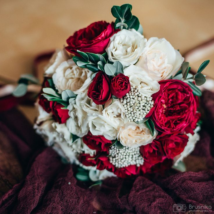 Hand-tied bouquet of David Austin roses, spray roses, Ohara roses, ozothamnus, pittosporum