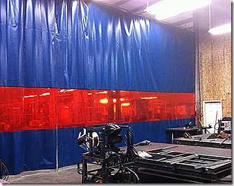 Industrial welding curtains are designed to resist flying sparks from arc welding while also providing a line of sight to the both sides of the curtain. This line of sight must then be tinted with a UV blocking film to protect the eye sight of nearby workers. These welding curtains come on a track or as a free-standing weld screen depending on your needs. The semi-transparent material can be a vision panel design as shown left, or it can be made as the entire curtain.