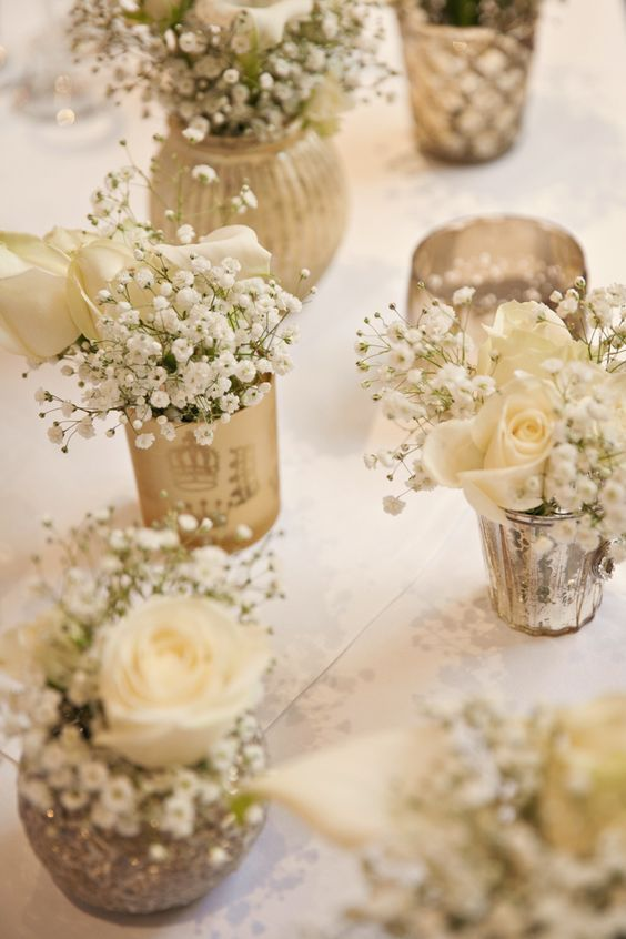 gold votives white flowers baby breath gypsohila tables centrepiece / http://www.deerpearlflowers.com/unique-wedding-centerpiece-ideas/4/