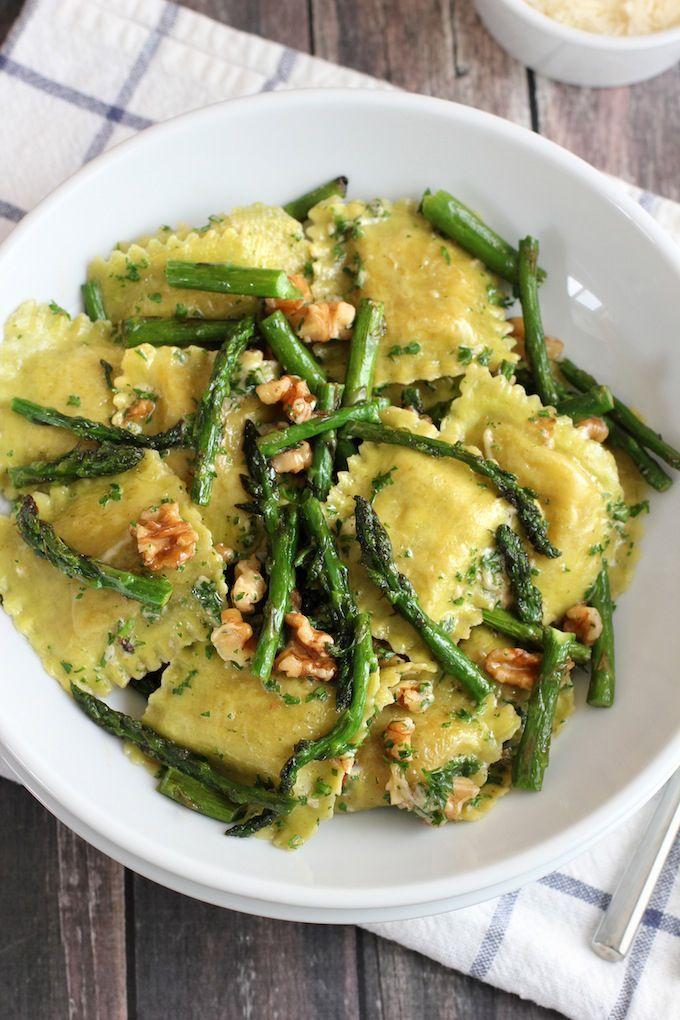 Ravioli with sautéed asparagus and walnuts.