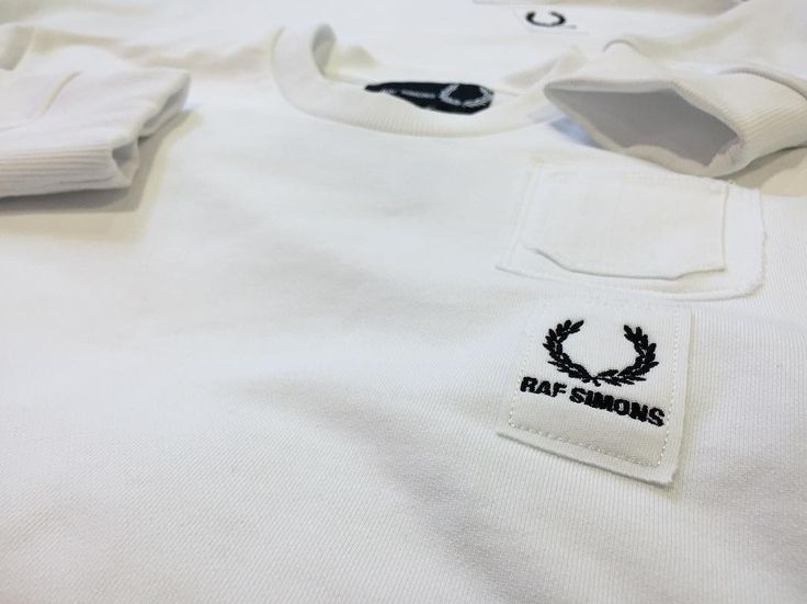 """We've had a restock on this season's Fred Perry by Raf Simons - the diamond white sweatshirt (110) is available in sizes 36"""" - 44"""" both in store and online now. If you missed out earlier this season now is your chance.  #fredperry #rafsimons #laurelwreath #collaboration #collection #menswear #mensstyle #mensfashion #luxury #luxuryfashion #ss17 #diamondwhite #philipbrownemenswear"""