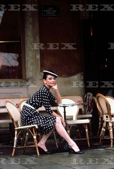 Audrey Hepburn, in Givenchy, photographed by Sergio Strizzi for a fashion editorial at the famous café Les Deux Magots, on Saint-Germain-des-Prés, in Paris (France), in March 1979.