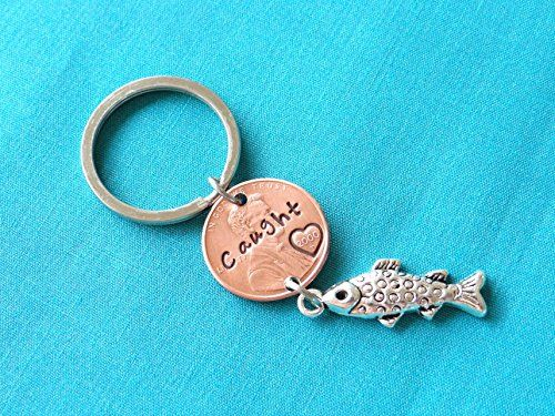 "Caught Penny Keychain. Stamped ""Caught"" Penny Keychain Please let me know what year you would like the penny to be, It is hand stamped to say ""Caught"" and and Heart is stamped around the year on the penny. Comes with a fish charm as well."