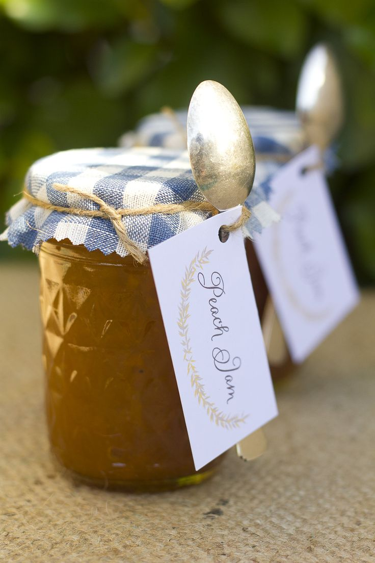 Give your guests a sweet wedding favour: House freshly made peach jam in antique jars covered in cheesecloth. New Zealand Weddings Magazine, Winter 2012 issue. Photography by Amanda Thomas.