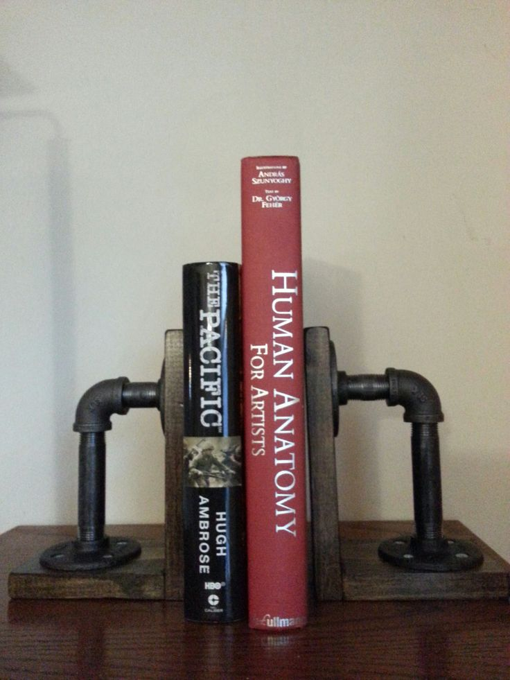 Industrial black iron pipe bookends by MdesignsAndCreations on Etsy https://www.etsy.com/listing/188501166/industrial-black-iron-pipe-bookends