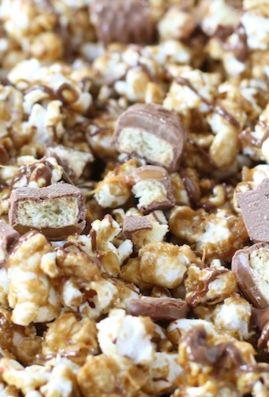 Twix Caramel Popcorn Recipe on twopeasandtheirpod.com Save your Halloween candy to make this popcorn!