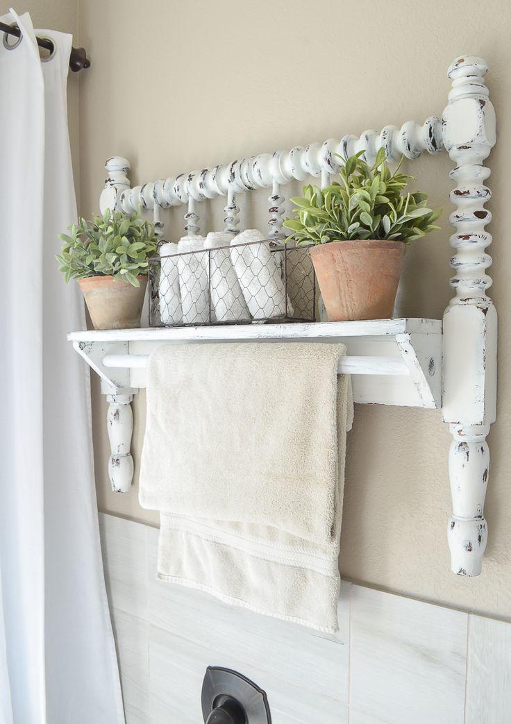 DIY towel bar from Jenny Lind bed frame. Great farmhouse style bathroom decor id…