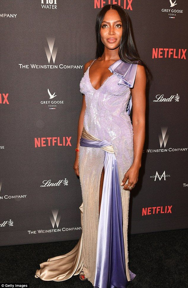 What a crowd: Petra was joined by a host of models at the bash - including Naomi Campbell, who dazzled in a purple and beige sequin gown