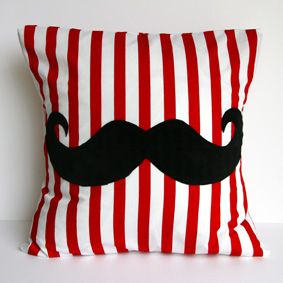 I kind of sort of love this.  Bonny Boutique - Online Store - Furry Moustache Cushion