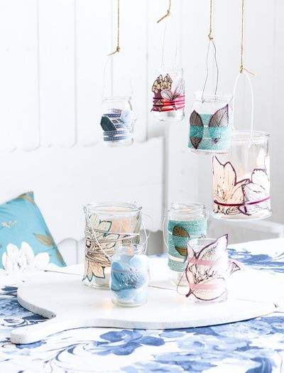 For little candles: glass jars wrapped in beautiful fabric and a wire for hanging
