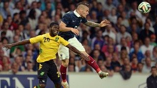 France's defender Mathieu Debuchy (R) vies with Jamaican's defender Kemar Lawrence (L)