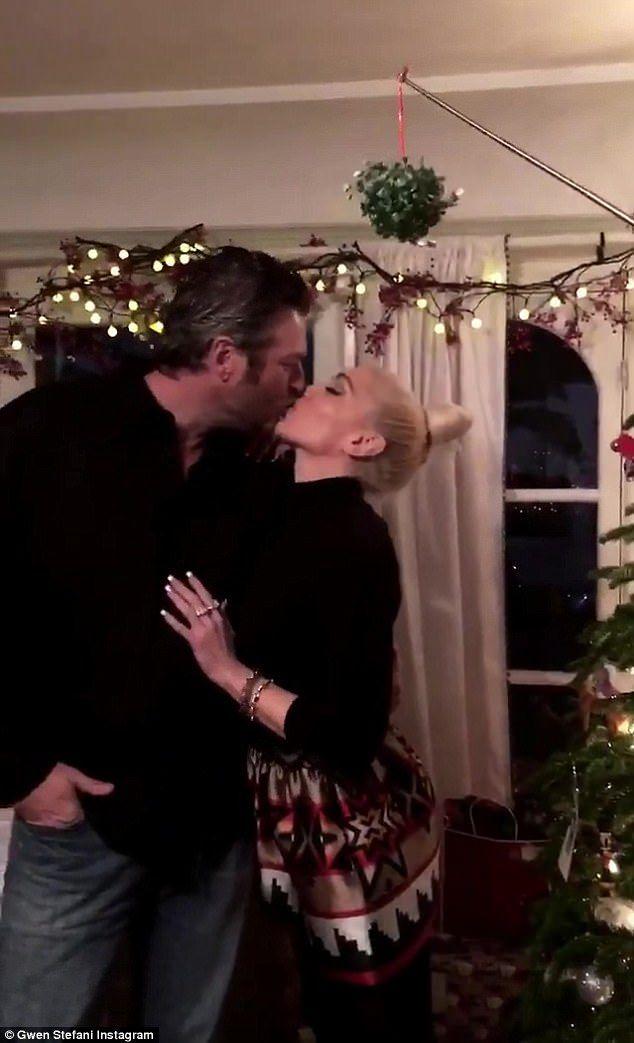 Mwah! Gwen Stefani, 48, and Blake Shelton, 41, kissed under the mistletoe on Christmas Eve Sunday