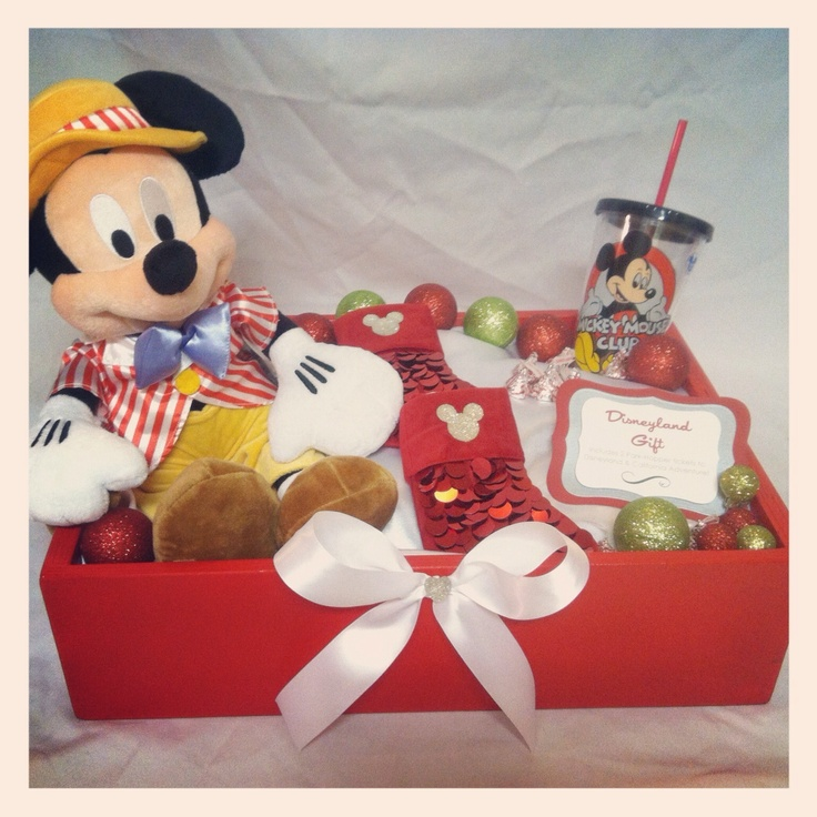 Disney gift! Custom wooden box I hand painted, added fabric (never tissue!), Mickey Mouse, blinged out little Mickey crystals to the stockings with 2 Disneyland Park Hopper tickets inside! Ornaments & candy & reusable Mickey cup finished this holiday gift up :) #davidcarlodesigns