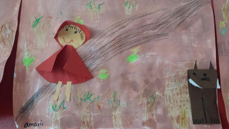 Roodkapje en de wolf. Roodkapje, cape van halve rode cirkel, kapje van kwart cirkel. Wolf, bovenkant rechthoek omvouwen en hoekjes van snuit knippen (oren), tanden knippen met kartelschaar.