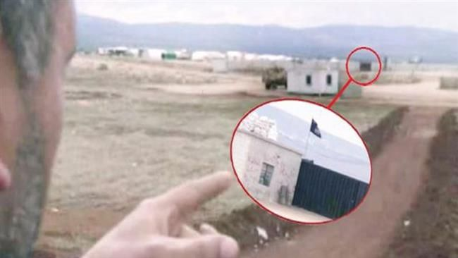 A sceengrab of footage released by the daily, Cumhuriyet, on June 12, 2015, shows a Turkish driver pointing to the ISIL base where he dropped off militants.