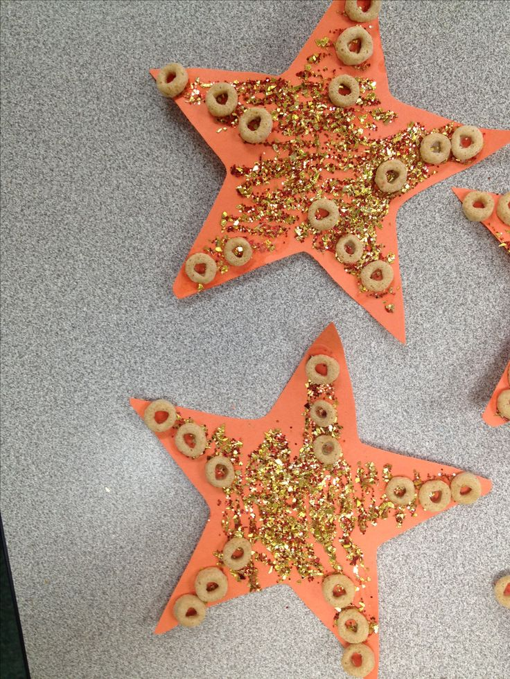 Art project I had my preschool class do during under the sea week... We used glitter and Cheerios to get the texture of starfish