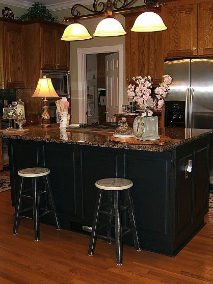 black island with oak cabinets