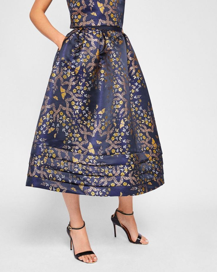 Kyoto Gardens jacquard midi skirt with pockets from Ted Baker. #wewantpockets #pocketsrock www.pocketsrock.com; dresses with pockets.  The Pockets Rock site contains affiliate links. If you make a purchase after following a link from the site, Pockets Rock may receive a small commission.