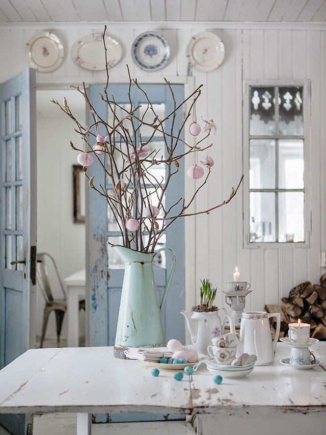 Love the blue painted french doors, and decorations