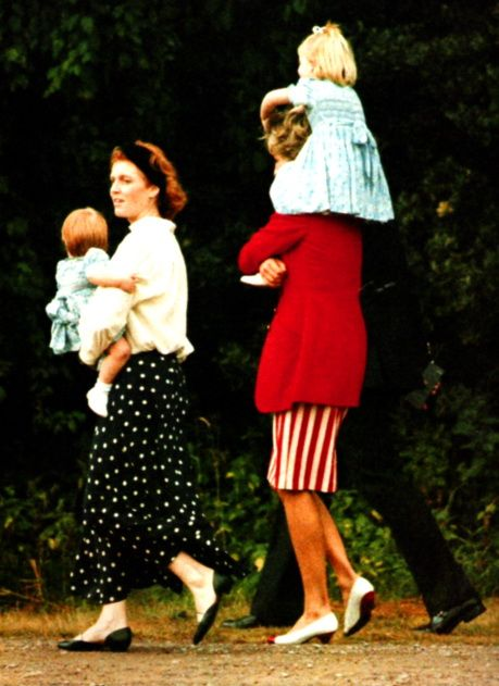 Diana and Sarah Ferguson.. Diana is carrying Princess Beatrice on her shoulders and Sarah has Princess Eugenie. 1991