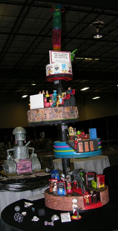 "There are 46 Sci-Fi Movies represented in this cake that won 1st place in the  ""2010 That Takes the Cake!"" competition.  Go to the link at the bottom to see detailed pics of each tier and see if you can identity the movies!  Rock on Kimberly!!!  http://kimberlychapman.com/crafts/cakes/2010-feb-alienfilmfestival.html"