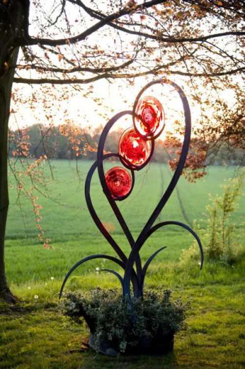 Forged steel and blown glass Organic/Abstract Sculptures #sculpture by #sculptor Jenny Pickford titled: 'Unfurl (Outsize Steel and Glass Flower Plant Sculptures)' #art
