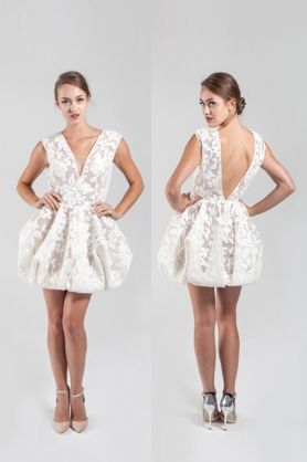White coated mesh bubble dress  The Charlie dress is a white coached mesh buble dress. This deep V, sleeveless dress has a beautiful floral lace print. It is designed to be fitted at throughout the bodice and poof out at the skip creating a voluminous bubble feel. #evening #bridal #bubbledress #fun #youthful #party #partydress #deepv #openback #white #whitemeshlacedetail #elegant #NARCES