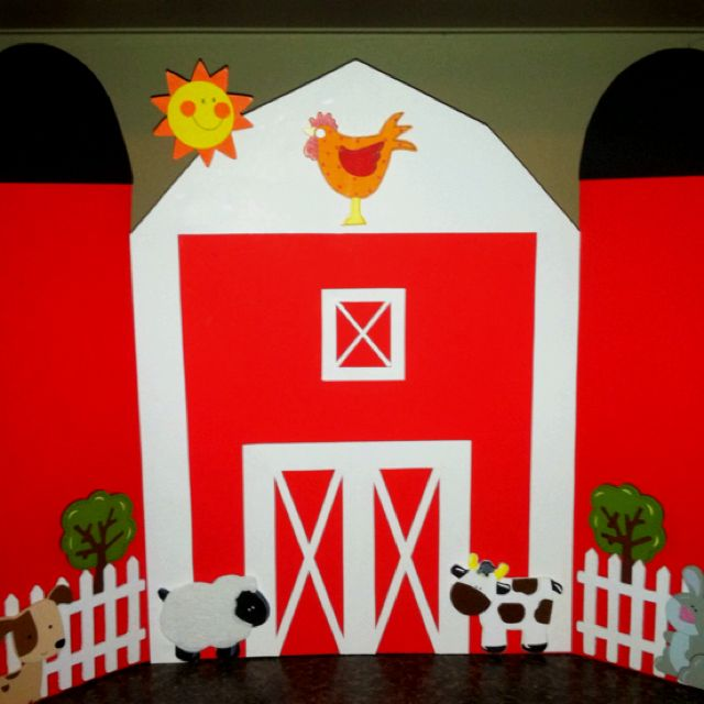 Red barn that I made from poster board and wood cut outs from hobby lobby. I am going to use it as a backdrop for the food at my son's first birthday party. It only cost about $5 and took about an hour.