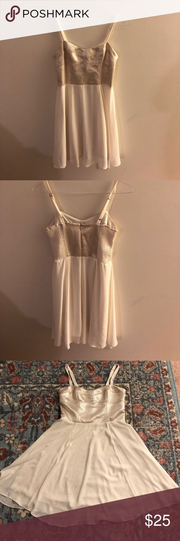 Gold cami shift dress This gold cami dress is perfect for the holidays throw on some res lipstick and you will surely stand out ! Express Dresses